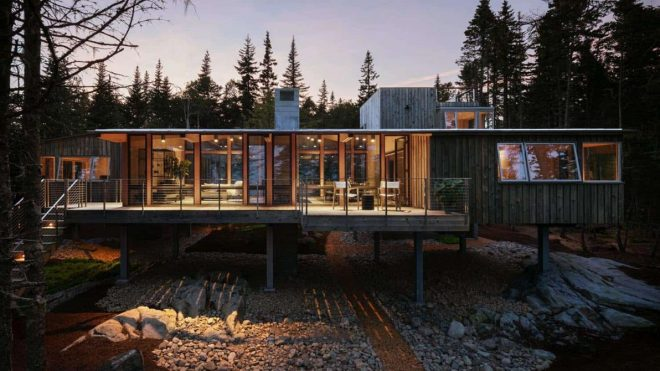 Coastal Cabin On Stilts With Ocean Views Peeking Through The Trees